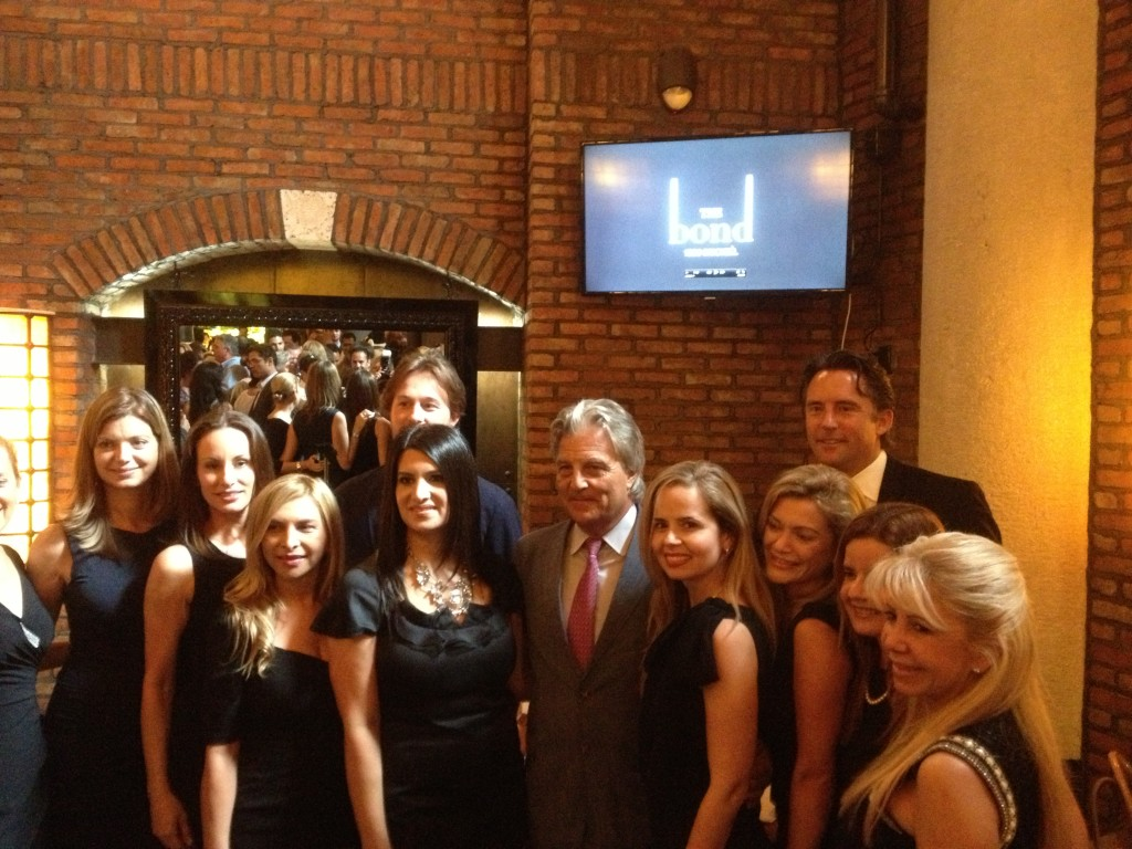 What a lucky guy that Alan Ojeda; taking the time to pose with the Bond girls.