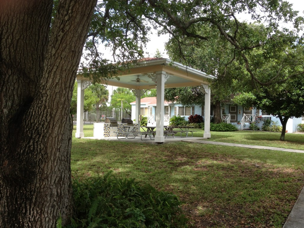 Barbecue area with picnic tables in the middle of the courtyard which is surrounded by the small multifamily cottages.